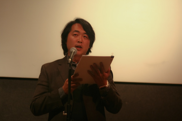 Sam Cha reads his confessional essay.